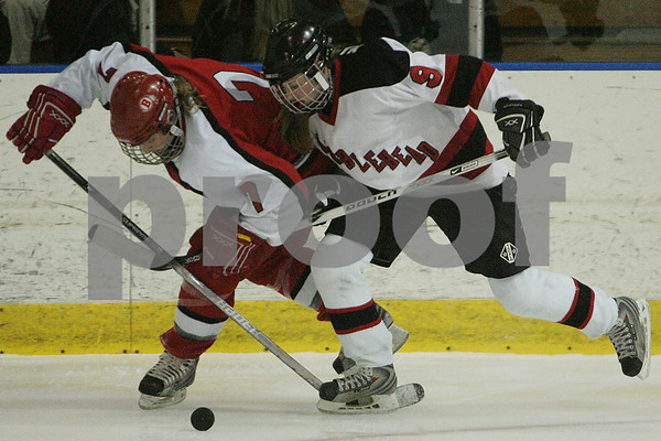 Salem: Marblehead junior Kelsey Maguire, right, battles for the puck along the boards with Barnstable senior Claire Toffey during the first period of the Header's 2-0 win over Barnstable in the first round of the state tournament playoffs in Salem on Tuesday. Photo by Matthew Viglianti/Staff Photographer Tuesday, February 24, 2009.