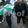 Danvers: Mia Caruso, 3, from Fairfield, Connecticut carries her umbrella while walking with her mother, Kelly, during the 21st Annual Walk for Hospice of the North Shore through Danvers on Sunday. The Carusos were walking in memory of Kelly's father-in-law, Frank. Photo by Matt Viglianti/Salem News Sunday, September 28, 2008