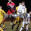 Weymouth: Masconomet junior John Miller leaps to challenge Nauset senior captain and goalkeeper Brett Conrad during the first half of the teams' state semifinal game in Weymouth on Tuesday. Photo by Matthew Viglianti/Staff Photographer Tuesday, November 18, 2008.