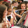 Salem: Rayna Ostrander, a fourth grader at Witchcraft Heights Elementary School in Salem, plays the flute with the all-city band during the annual Arts in the Evening student art exhibit and musical performance at Salem High School on Wednesday. Photo by Matthew Viglianti/Staff Photographer Wednesday, May 5, 2010.