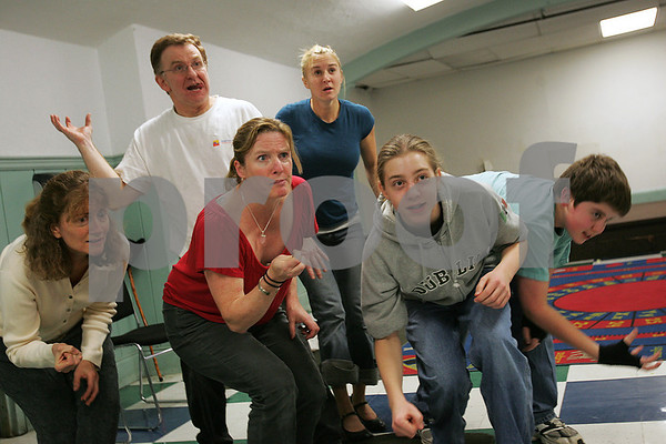 Salem: Members of the cast of A Child's Christmas in Wales rehearse a scene on Tuesday night. The play, which is being performed by the Salem Theatre Company, tells a nostalgic story about Chirstmas. From left to right are, Julie Korzenik, Steve Turner, Sarah Carlin, Callie Mescher, and brothers Ben and Nat Roberts. Photo by Matthew Viglianti/Staff Photographer Tuesday, November 25, 2008.