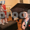 """Salem: Lydia King, right, walks through the scene with an umbrella as Jaclyn Jermyn maintains a pose on a riser during a dress rehearsal for the Salem Academy Charter School's production of """"This is Not a Pipe Dream"""" at Old Town Hall in Salem on Wednesday. King plays of the the four Anonymous Men, while Jermyn plays the role of Rene Magritte, in the one-act play about the surrealist artist Magritte's life. Photo by Matt Viglianti/Salem News Wednesday, December 10, 2008"""