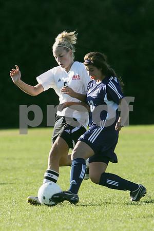 Swampscott senior Skylar Sabbag challenges Beverly senior captain Jess Shaw during their game at Beverly on Tuesday.
