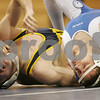 Danvers: St. John's Prep wrestler TJ Crabtree, right, works to pin Xaverian's captain Griffin O'Connor during their 125 pound match at the Prep's home meet against Xaverian on Wednesday. Crabtree won the match 13-8. Photo by Matthew Viglianti/Staff Photographer Wednesday, January 14, 2009.