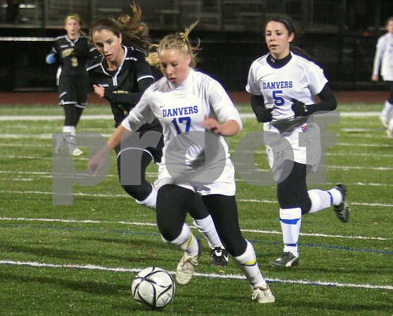 Lynn: Corey Presson, a sophomore forward for the Danvers Falcons, center, gets a step on Bishop Fenwick defense en route to scoring her first goal of the game for Danvers during the first half of the Division 2 North semifinal game in Lynn on Thursday. Persson scored a hat trick for the Falcons, who won the game 6-0 to advance to the next round of the playoffs. Photo by Matthew Viglianti/Staff Photographer Thursday, November 12, 2009.