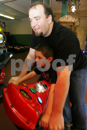 Salem: Aragorn 4, and his father Dusten, of Salem ride the Fast and the Furious game at the Salem Willows Arcade on Sunday afternoon. Photo by Matt Viglianti/Salem News Sunday, June 15, 2008