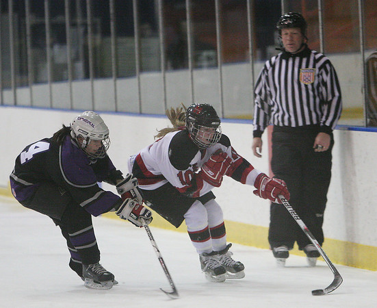 Salem: Lexie Laing from Marblehead, right, attempts to move the puck past Cathedral's Ellen Strycharz during the first period of their teams' game at Rockett Arena in Salem on Wednesday. Photo by Matthew Viglianti/Staff Photographer Wednesday, January 13, 2010.