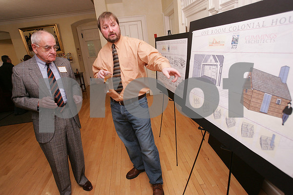 Ipswich: Architect Mathew Cummings explains his drawings to Donald Harriss during the kickoff event of Ipswich's yearlong celebration of its 375th anniversary at the Hellenic Center. Cummings and his friend Jim Whidden are constructing a house using plans and techniques from 1657, when houses were typically one room and built by hand. Photo by Matt Viglianti/Salem News Sunday, November 30, 2008