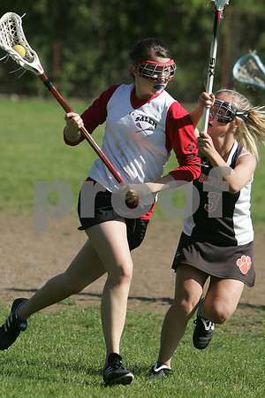Salem: Abbey Noone from Salem, left, shields the ball from Beverly's Corinne Woods while pushing an offensive attack during the Witches' home game against Beverly on Tuesday. Beverly won the game 13-11 after taking a 10-4 halftime lead. Photo by Matthew Viglianti/Staff Photographer Tuesday, May 19, 2009.