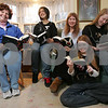 "Marblehead: The ""Twilight"" book series has become a hit with the girls in the Klein and Hackney families in Marblehead. From left, Heidi Klein and her daughter, Ariana, 13, and Karen Hackney and her daughters, Anne, 13, and Laura, 15. Photo by Matthew Viglianti/Staff Photographer Tuesday, November 18, 2008."