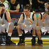 Lowell: From left, Bishop Fenwick seniors Mike Clifford, Phil Eagan, and Nick Cotoia hang their heads in dissapointment as they wait for the final horn ending the Crusaders' state tournament game against Watertown at the Tsongas Arena in Lowell on Sunday. The team lost 62-48. Photo by Matthew Viglianti/Staff Photographer Sunday, March 8, 2009.