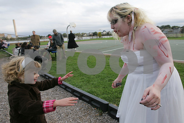 "Salem: ""Zombie Bride"" Amanda Charles from Brookline, NH plays with Blake Walton, 6, from Salem at Collins Cove Park in Salem before the Zombie Walk through the city on Sunday. Photo by Matt Viglianti/Salem News Sunday, October 05, 2008"