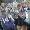Beverly: The Peabody High School girls varsity lacrosse team cheers as Jess Leslie (14) runs down the line before the start of the Tanners' away game against Beverly on Monday. Photo by Matthew Viglianti/Staff Photographer Monday, May 18, 2009.