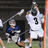 Cambridge: Garrett Campbell, a senior attack for St. John's Prep, gets a shot past Duxbury senior goalie Makar Zaverucha during the first half of the Division 1 state championship game between St. John's Prep and Duxbury at Harvard Stadium in Cambridge on Wednesday night. The Prep won the game 12-11 on a sudden death overtime goal by senior James Fahey to take the state title. Photo by Matthew Viglianti/Staff Photographer Wednesday, June 16, 2010.