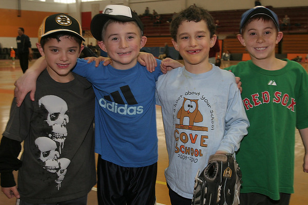 Beverly: From left to right, seven-year-olds Roger Tremblay, Brayden Clark, Joss Kyrouz, and Nathan Randazza participated in the 28th annual Beverly Little League indoor winter clinic at Beverly High School on Sunday. Photo by Matthew Viglianti/Staff Photographer Sunday, January 24, 2010.