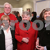 Peabody: From left to right, Wendy Mack, Jim Burke, Marie Bishop, and Dottie Bond, pose during the Making a Difference in Peabody Foundation Fundraiser at the Cassidy Museum on Wednesday. Photo by Matt Viglianti/Salem News Wednesday, March 04, 2009