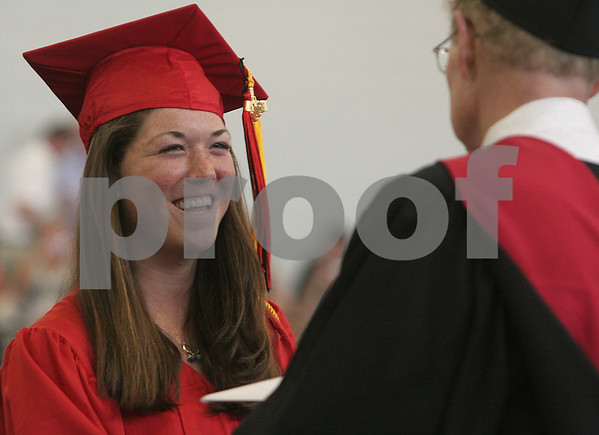 Marblehead: Ryan Heffrin, valedictorian of the Marblehead High School class of 2009, smiles while receiving her diploma from Principal John M. Ziergiebel during graduation ceremonies at Marblehead High School on Sunday. Photo by Matthew Viglianti/Staff Photographer Sunday, June 7, 2009.