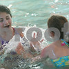 Danvers:  Julia Zabar, 11, left, reacts to being splashed by Rory Torstensson, 6, during an afternoon in the pool at the Coco Key Water Resort in Danvers on Thursday. The girls visited the park with the Jewish Community Center in Marblehead, which purchased 101 tickets for the occassion. Photo by Matthew Viglianti/Staff Photographer Thursday, December 25, 2008.