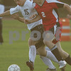 Beverly: Sam Terrill from Marblehead, right, fights to dribble past Beverly's XXXX Huxley-Cohen during the second half of their teams' game in Beverly on Monday. Terrill scored to give Marblehead a 1-0 halftime lead. Photo by Matt Viglianti/Salem News Monday, October 13, 2008