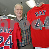 Peabody: Alan Forbes, owner of Sports Collectibles in Peabody, says sales of Jason Bay Red Sox shirts and jerseys have met his expectations for the arrival of a superstar player to a Boston area team. Forbes will continue to sell his stock of Manny Ramirez gear at reduced prices, and has been receiving calls from people interested in buying Ramirez's Los Angeles Dodgers shirts. Photo by Matt Viglianti/Salem News Wednesday, August 20, 2008