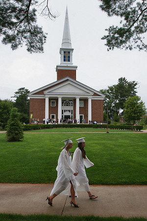 Hamilton: A pair of Hamilton-Wenham High School seniors walk past the Gordon College chapel before the start of graduation ceremonies for the class of 2010 on Sunday. Photo by Matthew Viglianti/Staff Photographer Sunday, June 13, 2010.