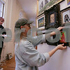 Salem: Wendy Snow-Lang takes an inventory of her husband Charles Lang's artwork as he hangs another piece in preparation of the upcoming Terror Fantasies Art Show in Salem that the couple has been helping to run for almost 20 years. Photo by Matt Viglianti/Salem News Tuesday, October 07, 2008