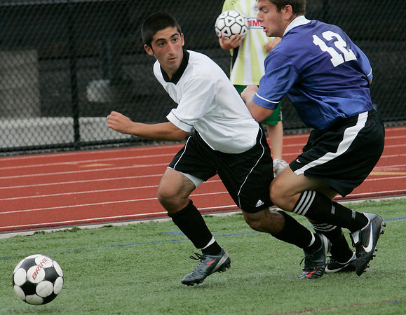 Lynn: Kyle Taylor of Swampscott, left, looks to send in a cross after beating Caleb Rogers of Wilmington during the 15th Agganis All-Star Men's Soccer Classic in Lynn on Tuesday. Photo by Matthew Viglianti/Staff Photographer Tuesday, July 7, 2010.