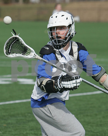 Danvers: Topher Jung concentrates on catching a pass during a drill at tryouts for the freshman lacrosse team at St. John's Prep in Danvers on Monday. Monday marked the first day of the spring sports season on the North Shore. Photo by Matthew Viglianti/Staff Photographer Monday, March 16, 2009.