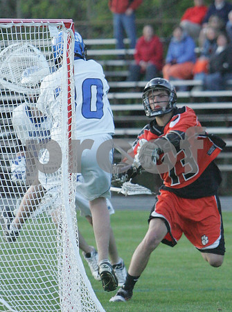 Danvers: Ryan Nolan from Beverly fires a shot past Danvers goalie Ryan Fecteau during Beverly's 8-4 win over the Falcons in Danvers on Tuesday. Nolan tallied two goals and two assists for the Panthers. Photo by Matthew Viglianti/Staff Photographer Tuesday, May 12, 2009.