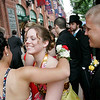 Boston: Nancy Brown, center, receives a hug from classmate Tiana Alfonso as Kyle Tuneburg looks on outside Fenway Park in Boston, where the Beverly High School prom was held on Thursday. Photo by Matthew Viglianti/Staff Photographer Thursday, June 10, 2010.