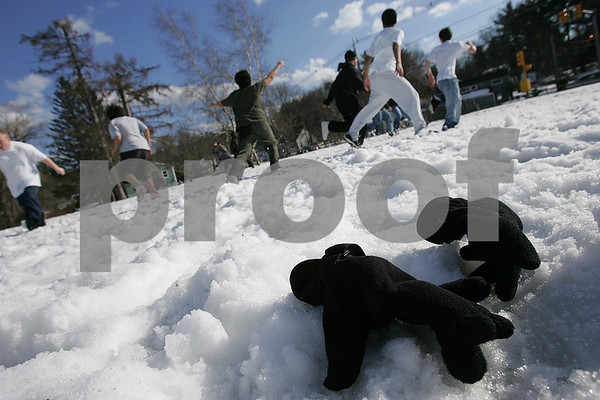 Peabody: Warm temperatures on Sunday afternoon allowed kids from the NFI Massachusetts Shelter Care Program in Peabody to play a game of touch football in the snow, in shorts and T-shirts and without gloves. Photo by Matthew Viglianti/Staff Photographer Sunday, February, 8, 2009.