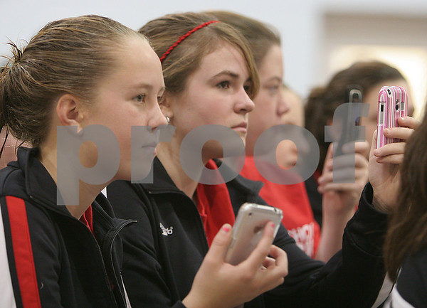 Beverly: From left, Megan Alexander, Molly Twomey, and Bridgette Townsend listen and take pictures with their cell phones as olympic gold medalist Ryan Lochte speaks to a crowd of North Shore swimmers at the Sterling Center YMCA in Beverly about his Olympic experiences in Beijing and his history as a competitive swimmer on Sunday morning. Photo by Matt Viglianti/Salem News Sunday, November 02, 2008