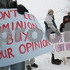 Salem: Protestors hold signs during a rally held by HeathLink outside Salem Harbor Station on Sunday afternoon. The group advocates for the end of coal use as energy in the United States. Photo by Matthew Viglianti/Staff Photographer Sunday, March 1, 2009.