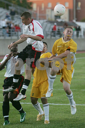 Salem: Salem senior captain Mike Steeves leaps to head the ball over Lynn Classical defender senior Danny Henriquez during the first half of Salem's home game at Bertram Field on Thursday. Photo by Matt Viglianti/Salem News Thursday, September 11, 2008