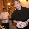 Salem: Jennifer Normant from the Hawthorne Hotel describes one of her dessert dishes to a diner at the Cookie Creations fundraiser in Salem on Thursday. Each participating chef used Girl Scout Cookies in their dessert treats. Normant used Shortbread, Peanut Butter Patties, and Caramel DeLites for her three different cheescakes. Photo by Matthew Viglianti/Staff Photographer Thursday, January 21, 2010.
