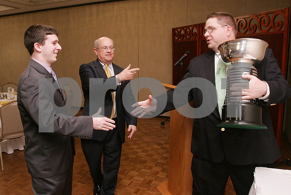 Salem: Gregory Doonan from Peabody shakes hands with Salem News sports editor, Phil Stacey, before receiving the Salem News Student-Athlete Award trophy at a banquet in Salem on Wednesday. Doonan was chosen by a panel of judges, including Stacey and Salem News editorial page editor, Nelson Benton, center, out of 14 nominees representing each high school in the paper's coverage area. Photo by Matthew Viglianti/Staff Photographer Wednesday, April 1, 2009.