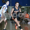 Danvers: Beverly captain Kellie Shea, right, drives past Danvers sophomore Kellie Macdonald during the first period of the Panther's away game against Danvers on Tuesday. Photo by Matthew Viglianti/Staff Photographer Tuesday, January 13, 2009.