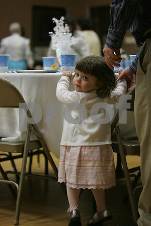 Beverly: Isabella Karaganis, 2, from Beverly, wears her Sunday best at an Easter Sunday breakfast at the First Baptist Church in Beverly on Sunday morning. Photo by Matthew Viglianti/Staff Photographer Sunday, April 12, 2009.