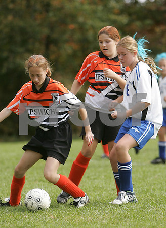 Peabody: Natalie Lawrence, left, and Ciara O'Flynn, center, from the U-12 Ipswich Strikers, defend the ball against Allison Hennigan from the U-12 Peabody Miracles during the second half of their teams' semi-final match-up in the 18th annual Peabody Youth Soccer Columbus Day Tournament on Monday. Peabody won the game 2-0 to advance to the final. Photo by Matt Viglianti/Salem News Monday, October 13, 2008