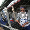 Lowell: Danvers junior captain Joanna Zecha packs her equipment bag in the Falcons' dugout after their 5-3 loss to Lexington in the Division 1 North final in Lowell on Monday. Photo by Matthew Viglianti/Staff Photographer Monday, June 8, 2009.