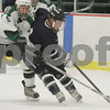 Hamilton: Bob Adam, a sophomore at Pingree, right, works to fight off a check by Hebron Academy's Matt Siracusa during the second period of the Highlanders' home game agaisnt Hebron Academy on Wednesday. Photo by Matt Viglianti/Salem News Wednesday, January 21, 2009