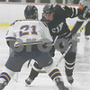 North Billerica: St. John's Prep senior Derek Dubois, right, tries to maneuver past Arlington Catholic senior Dan Williams during the second period of their teams' Division 1 state tournament semifinal game in North Billerica on Wednesday. Photo by Matt Viglianti/Salem News Wednesday, March 04, 2009