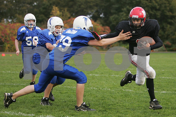 Marblehead: Matt Millett from Marblehead, right, uses a stiff arm to break through a tackle attempt by Danvers' Michael Baldini during the Marblehead youth football team's 22-8 win over Danvers on Sunday afternoon. Photo by Matt Viglianti/Salem News Sunday, October 19, 2008