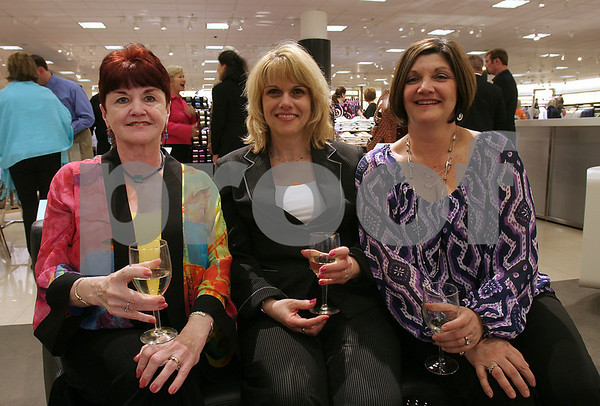Peabody: From left, Geri Drohan from Peabody, Nancy Fucarile, from Lynnfield, and Cheryl Lombardi from Peabody, sit on a sofa in the shoe department at the Nordstrom North Shore Mall opening gala on Wednesday night. Photo by Matthew Viglianti/Staff Photographer Wednesday, April 15, 2009.