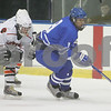 Salem: Jason Carucci, a junior at Danvers High School, skates ahead of Beverly junior Ryan Lally (3), and sophomore Troy Cabral, during the first period of the Falcons' game against Beverly in Salem on Wednesday. Photo by Matt Viglianti/Salem News Wednesday, February 04, 2009