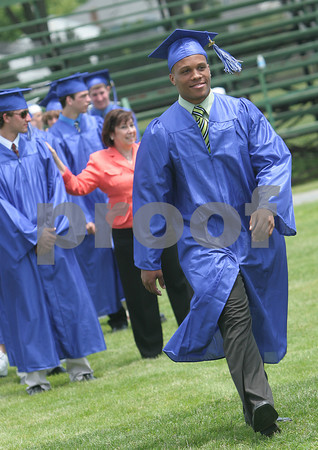 Swampscott: Attired in a blue cap and gown, James Payen walks towards his seat during the processional ceremony at graduation exercises for the Swampscott High School class of 2009 at Blocksidge Field on Sunday. Photo by Matthew Viglianti/Staff Photographer Sunday, June 7, 2009.