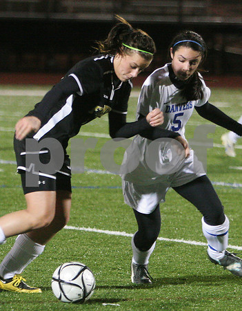 Lynn: Keri Acheson, a Bishop Fenwick junior, left, tries to advance the ball upfield for the Crusaders as Joanna Zecha, a Danvers senior, defends the play during the Division 2 North semifinal game in Lynn on Thursday. Danvers advances to the next round of the playoffs after a 6-0 win over Bishop Fenwick. Photo by Matthew Viglianti/Staff Photographer Thursday, November 12, 2009.