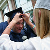 Hamilton: Ciara Schaub helps Ryan Counihan adjust his cap as the Hamilton-Wenham class of 2010 prepares for graduation ceremonies at Gordon College on Sunday. Photo by Matthew Viglianti/Staff Photographer Sunday, June 13, 2010.