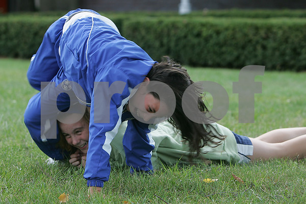 Salem: Rebecca Sabino, 9, cartwheels over Katherine Scacchi, 10, on the lawn outside the O'Keefe Center at Salem State before attending a Salem State women's soccer match with their Peabody travel team on Tuesday afternoon. Photo by Matt Viglianti/Salem News Tuesday, September 16, 2008
