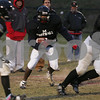 Marblehead: The Marblehead coaching staff watches as senior running back Brandon Lee looks for a hole during practice on Monday afternoon in preparation of the Magicians' Thanksgiving day game against rival Swampscott. Photo by Matthew Viglianti/Staff Photographer Monday, November 24, 2008.